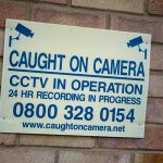 Caught on camera sign on brick building