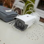 White CCTV camera on side