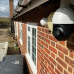 Residential CCTV installation on side of property