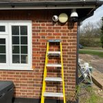 Essex home with CCTV cameras and yellow ladder